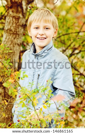 boy in fall time in forest - stock photo