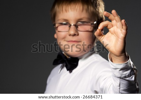 Boy in formal clothes gesturing ok