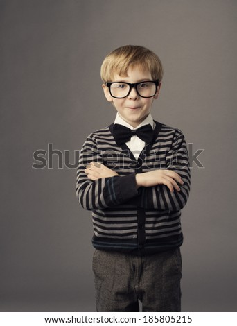 boy in funny glasses, little child fashion studio portrait, kid smart casual clothing, arms crossed  - stock photo