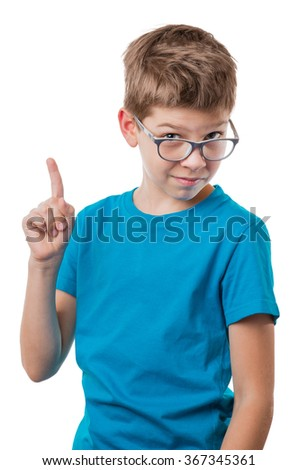 Boy in glasses showing thumbs up gesture, isolated on white background - stock photo