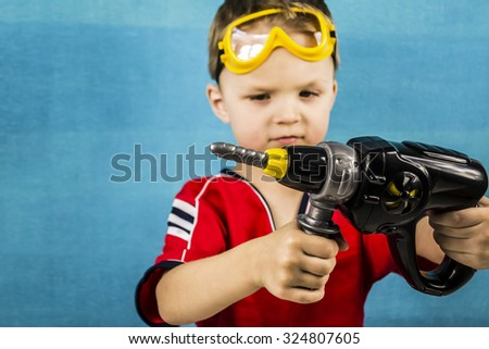 Boy in goggles and construction tools