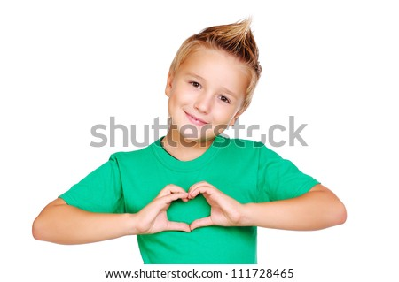 Boy in green tshirt making heart symbol with hands - stock photo