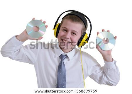 Boy in headphones holding two discs - stock photo