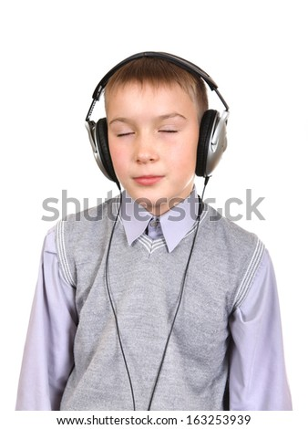 Boy in Headphones listen the music Isolated on the White Background - stock photo