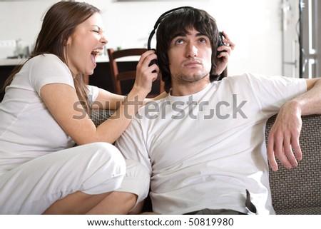 Boy in headphones with girl - stock photo