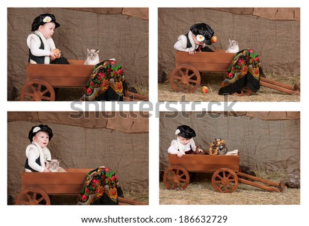 boy in national costume sits in a cart, playing with the cat - stock photo