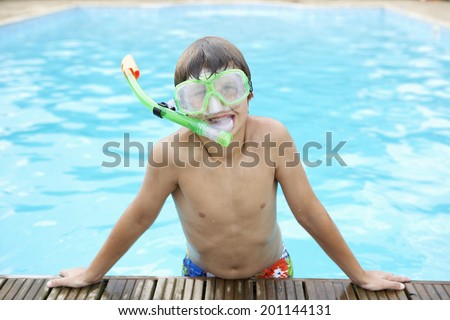 Boy in outdoor swimming pool - stock photo