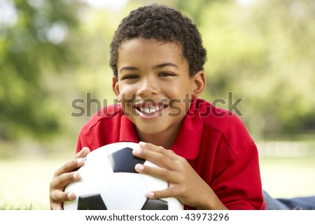 Boy In Park With Football - stock photo