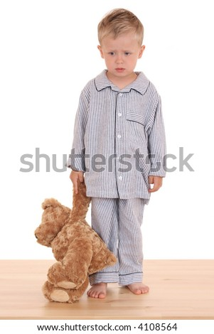 boy in pijama with his teddy bear isolated on white - stock photo