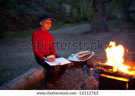 Boy in red and night camp