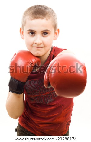 Boy in red boxing gloves - stock photo