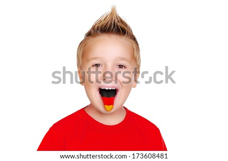 boy in red shirt   with german flag on his tongue - stock photo