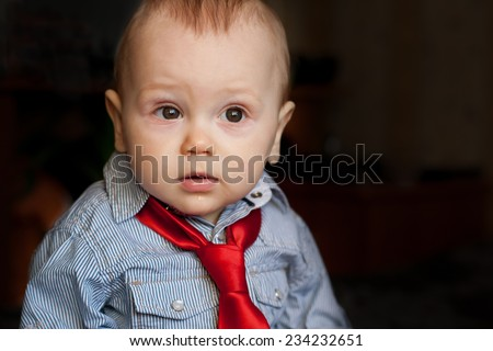 boy in red tie and blue shirt