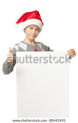 Boy in Santa hat holding blank banner showing thumb up sign, isolated on white background - stock photo