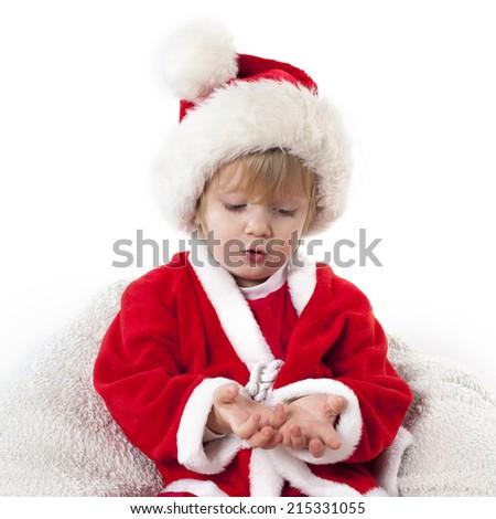 boy in Santa�´s hat showing something - stock photo