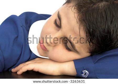 boy in school uniform  looking tired and sleepy