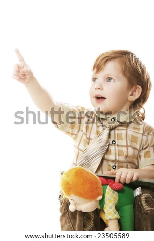 Boy in shirt and tie pointing with forefinger