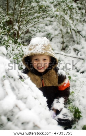 Boy in snow - stock photo