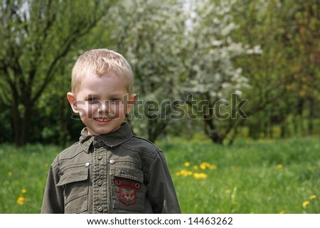 Boy in spring scenery - stock photo