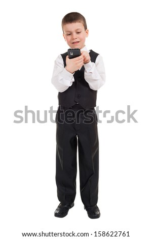 boy in suit dial on phone - stock photo