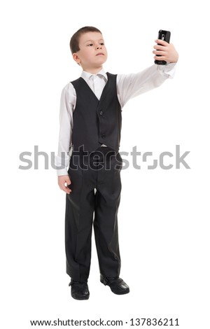boy in suit talk on phone - stock photo