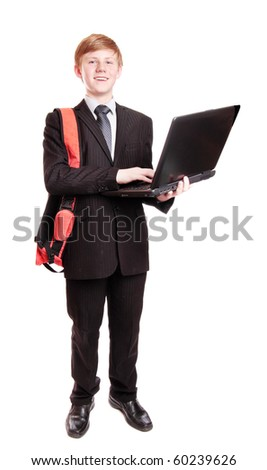 Boy in suit with notebook - stock photo