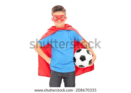 Boy in superhero costume holding a football isolated on white background - stock photo