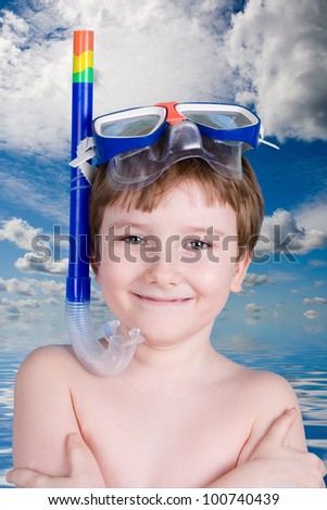 Boy in swimming mask against the sea - stock photo
