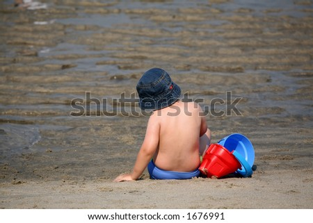 boy in the beach - stock photo