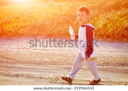 boy in the desert at the  sunset