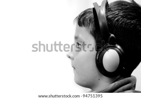 Boy in the headphones - stock photo