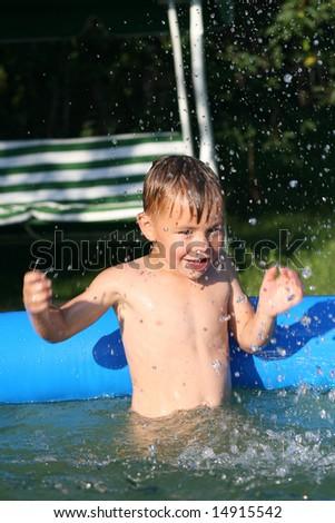 boy in the pool - stock photo