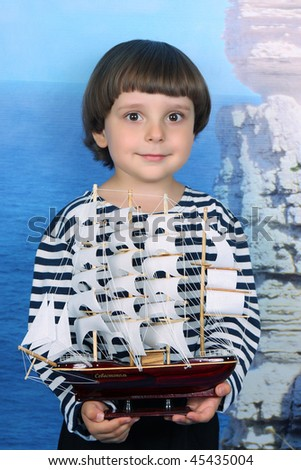 boy in the sea with a ship clothing
