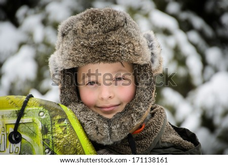 Boy in the winter hat - stock photo