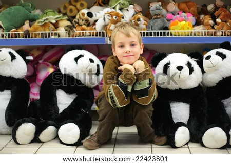 Boy in toy shop - stock photo