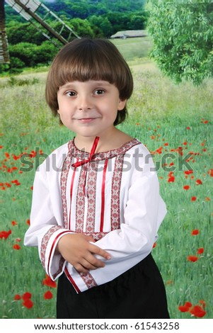 boy in traditional costume against the backdrop of the field