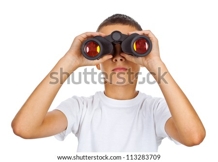 Boy in white shirt looking through binoculars isolated over white - stock photo