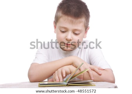 Boy in white shirt reading book hands folded