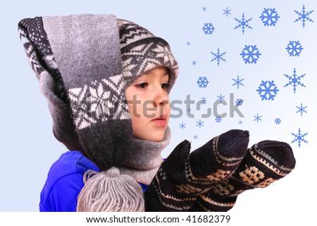 boy in winter cap with flecks of snow - stock photo