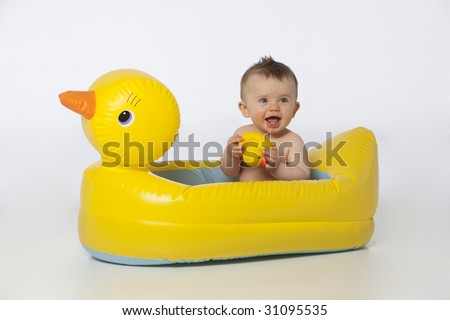boy in yellow duck tub - stock photo