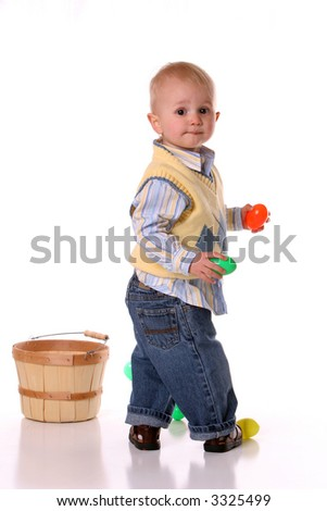 boy in yellow with easter basket
