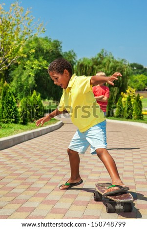 Boy inappropriate footwear trying to learn skateboarding
