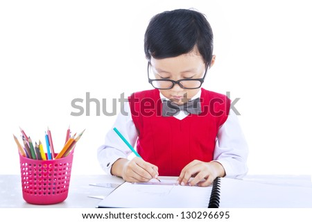 Boy is drawing with his pencil color isolated on white - stock photo