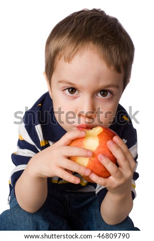 boy is eating apple isolated on white