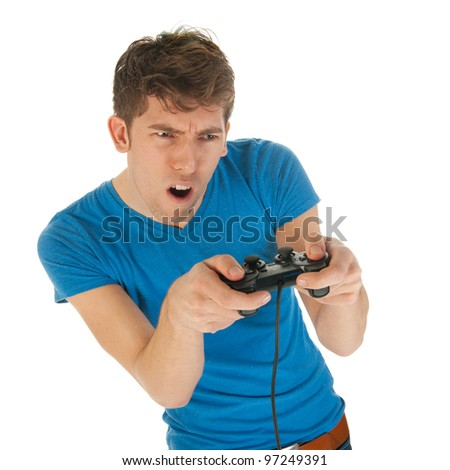 Boy is excitement about playing the computer game with controller