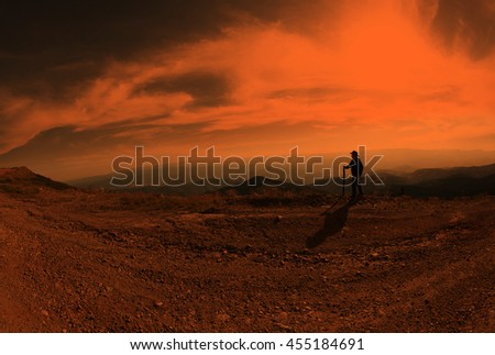 Boy is hiking on beautiful mountain sunset
