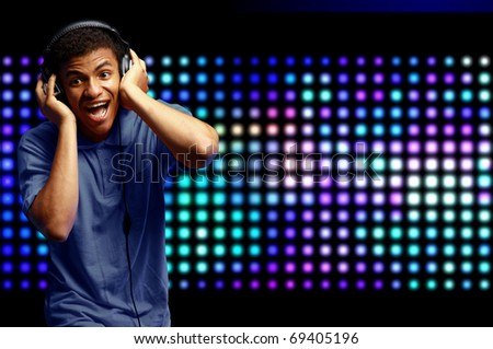 Boy is is listening to music - stock photo