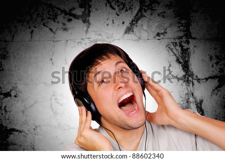 Boy is is listening to music track