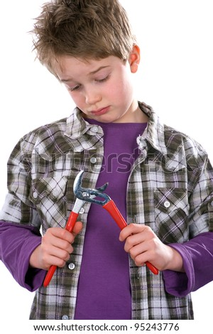 boy is looking  skeptical on his tongs - stock photo