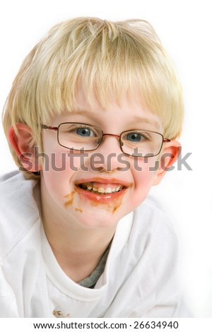 Boy is making a mess with chocolate - stock photo